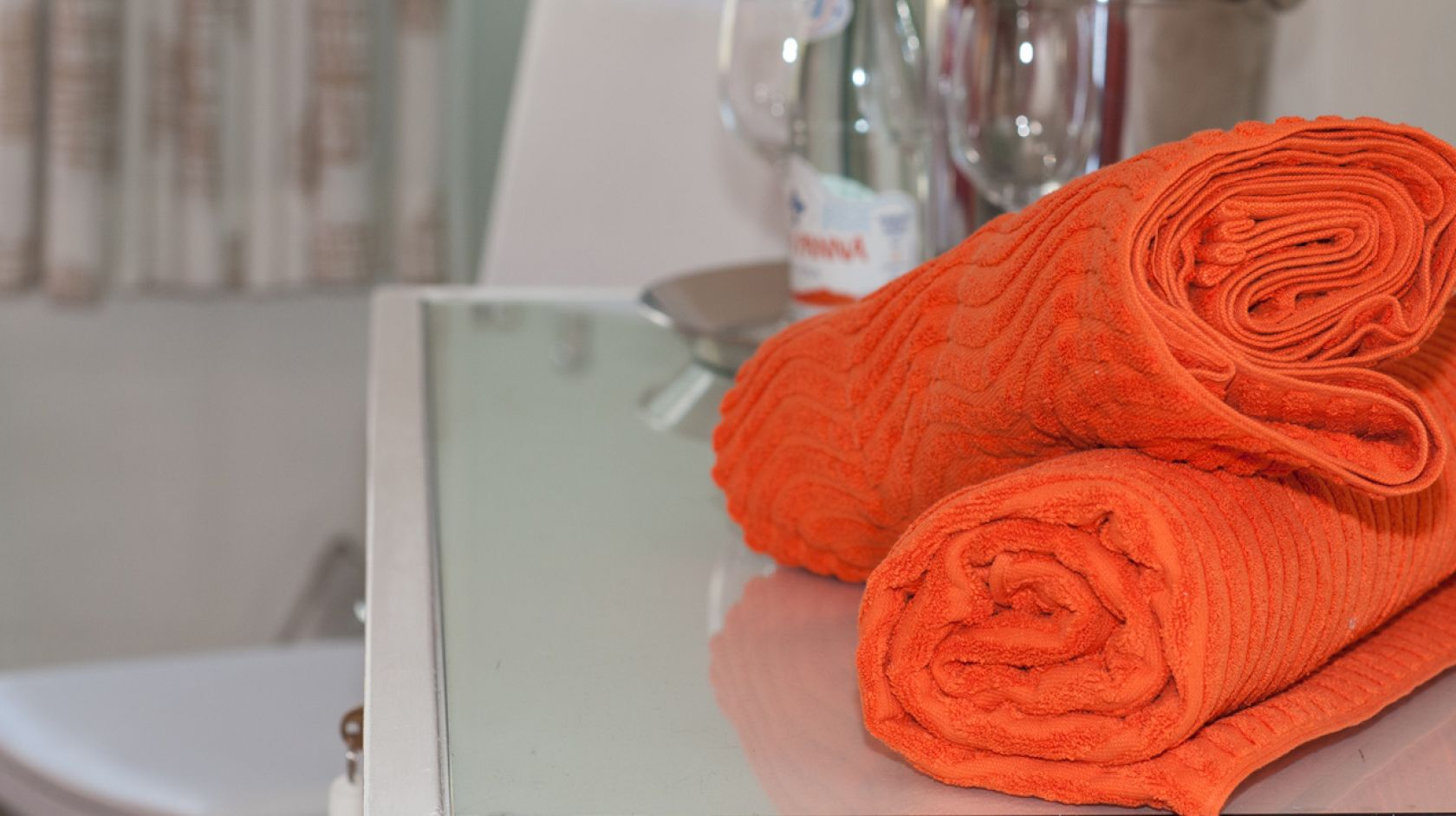 orange towels in a bathroom